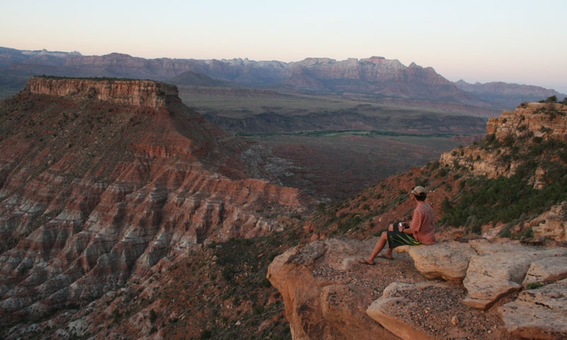 Sitting on the edge of Hurricane Cliffs at Gooseberry Mesa